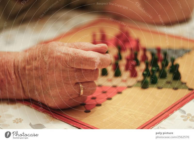 Pensioner plays Halma Lifestyle Leisure and hobbies Playing Female senior Woman Male senior Man Grandparents Senior citizen Grandfather Grandmother Adults Hand