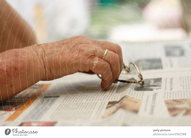 Hand of an elderly lady Woman Adults Female senior Family & Relations Senior citizen 60 years and older Beginning Fear Grandmother Eyeglasses Newspaper