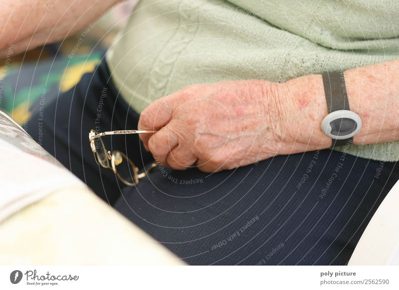 Pensioner's hand with glasses Healthy Care of the elderly Woman Adults Female senior Male senior Man Grandparents Senior citizen Grandmother Life Arm Hand