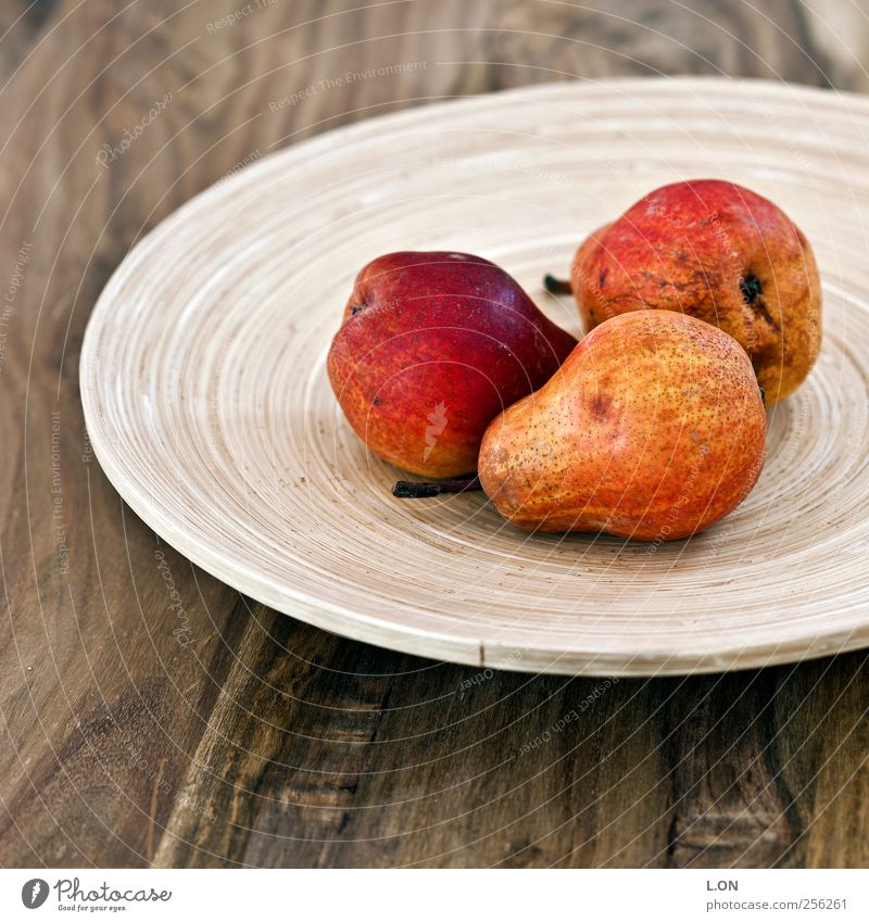 red pears Food Fruit Pear Nutrition Organic produce Vegetarian diet Bowl Table Kitchen Wood Delicious Juicy Sweet Red Colour photo Subdued colour Interior shot