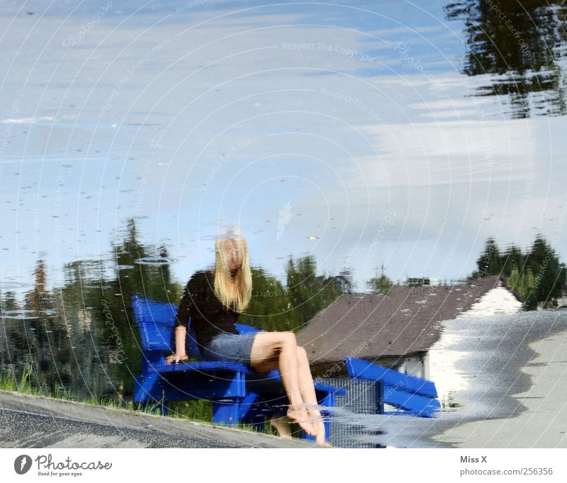 surface world Human being Feminine Woman Adults 1 Water Lake Sit Legs Reflection Water reflection Puddle Park bench Colour photo Exterior shot Motion blur