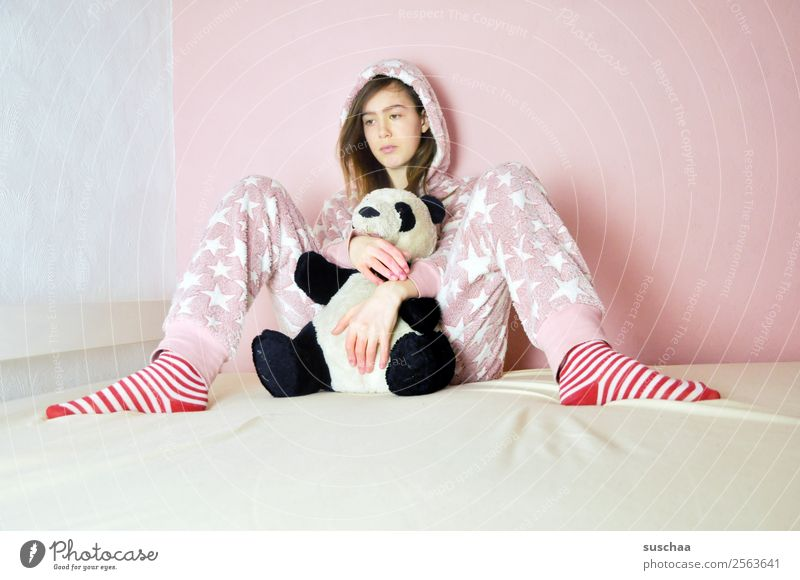 teenager sits somewhat lost on her bed with a cuddly toy in the poor girl Child Young woman 13 - 18 years Youth (Young adults) Puberty 14-year-old Pink