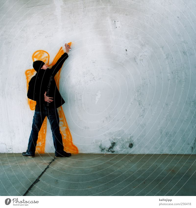 Human being Man Adults Graffiti Wall (building) Wall (barrier) Art Body Orange Masculine Lifestyle Culture Jeans Painting and drawing (object) Jacket Cap
