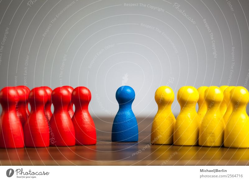 Single figure between two groups in different colors Human being Yellow gray blue concept confrontation difference game left leisure mediation mediator
