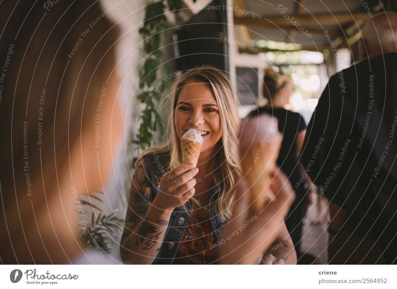 tattooed female eating ice cream with best friend Dessert Ice cream Eating Lifestyle Shopping Joy Happy Beautiful Summer To talk Human being Woman Adults