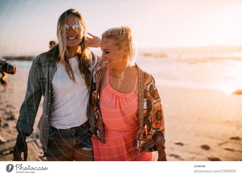two happy women enjoy walking at beach with sunny weather Lifestyle Style Joy Happy Beautiful Leisure and hobbies Vacation & Travel Trip Summer Beach Ocean