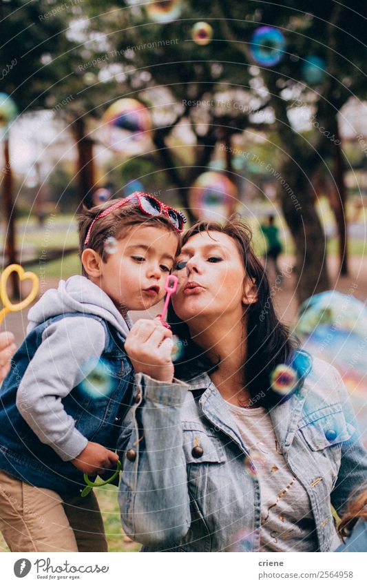 mother and son playing with soap bubbles in park Lifestyle Joy Happy Beautiful Playing Vacation & Travel Summer Child Human being Baby Boy (child) Woman Adults