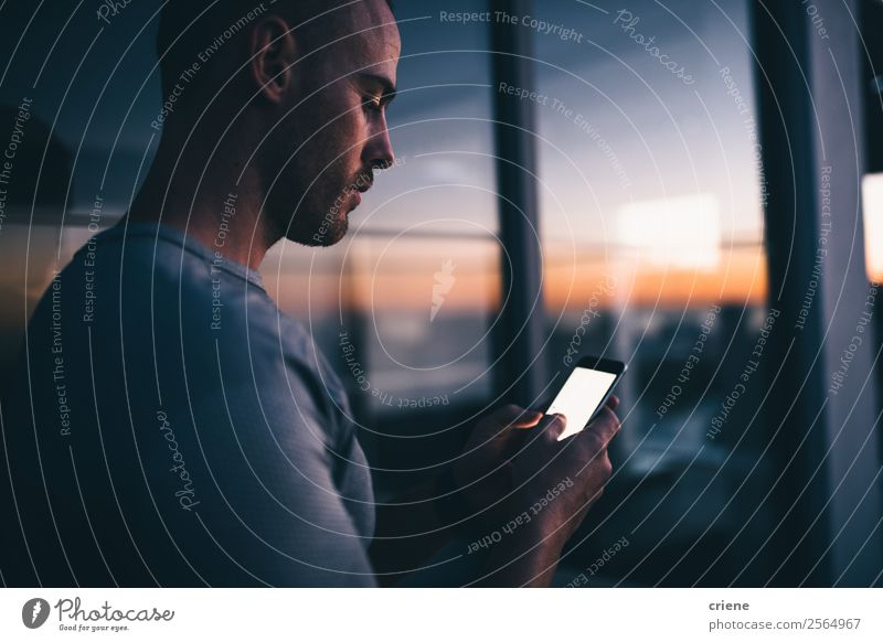 men standing in front of window with smartphone while sunset Lifestyle Work and employment Office Business Telephone PDA Screen Technology Internet Man Adults