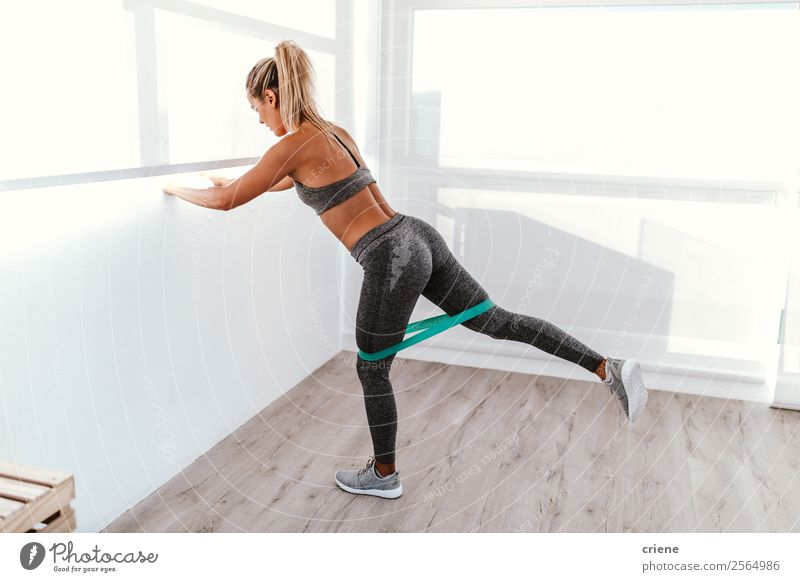 athletic young woman doing excercise with elastic band Lifestyle Beautiful Body Wellness Relaxation Sports Yoga Human being Woman Adults Band Underwear Movement