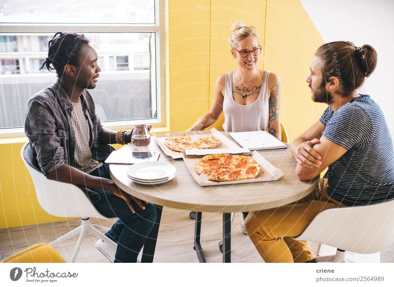mixed race group of colleagues having pizza while working Eating Lunch Dinner Fast food Happy Beautiful Academic studies Work and employment Office Business