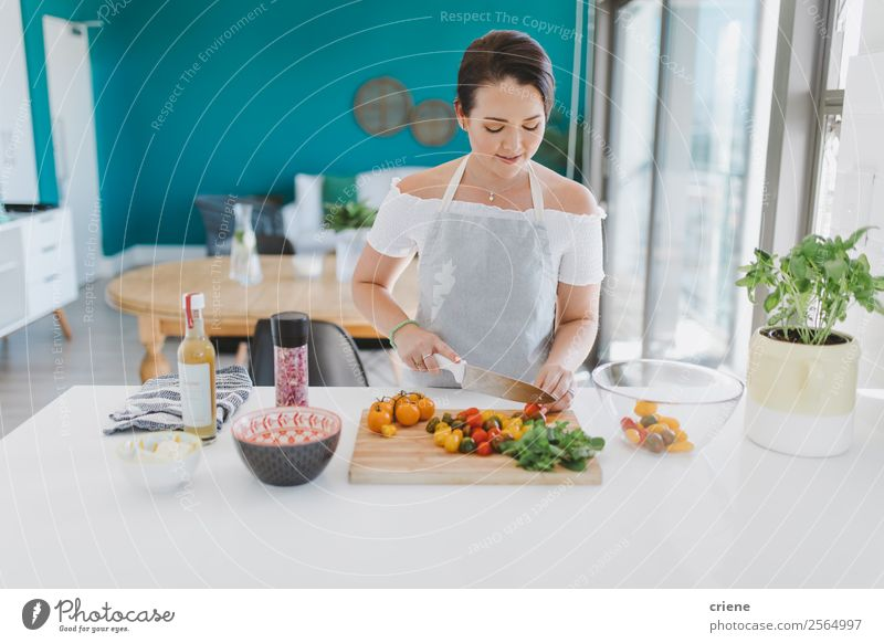 young woman preparing healthy salad in kitchen Vegetable Nutrition Eating Vegetarian diet Plate Lifestyle Joy Happy Health care House (Residential Structure)