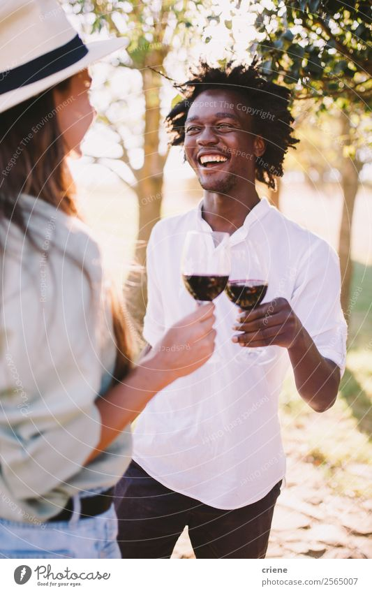 man and woman doing wine tasting outside Drinking Alcoholic drinks Lifestyle Happy Beautiful Summer Woman Adults Man Couple Nature Tree Park To enjoy Smiling