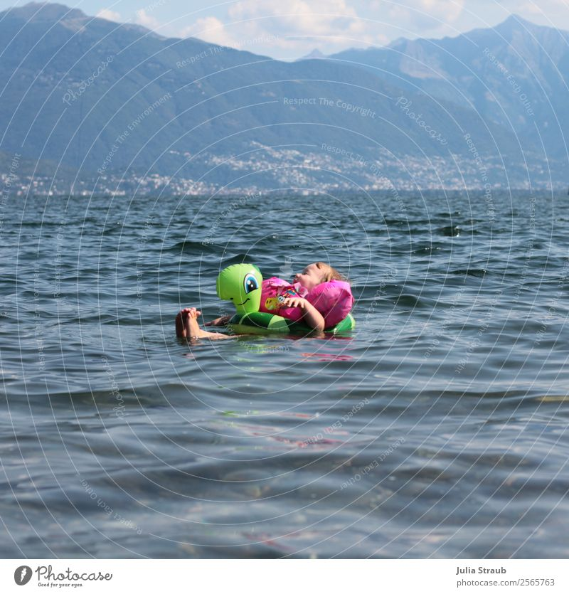 Child enjoy swimming Swimming & Bathing Feminine Toddler 1 Human being 1 - 3 years Water Clouds Summer Beautiful weather Mountain Lake Lago Maggiore Italy