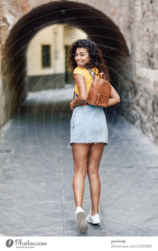 Young African tourist woman with black curly hairstyle Woman Human being Youth (Young adults) Young woman Beautiful Joy 18 - 30 years Black Face Street