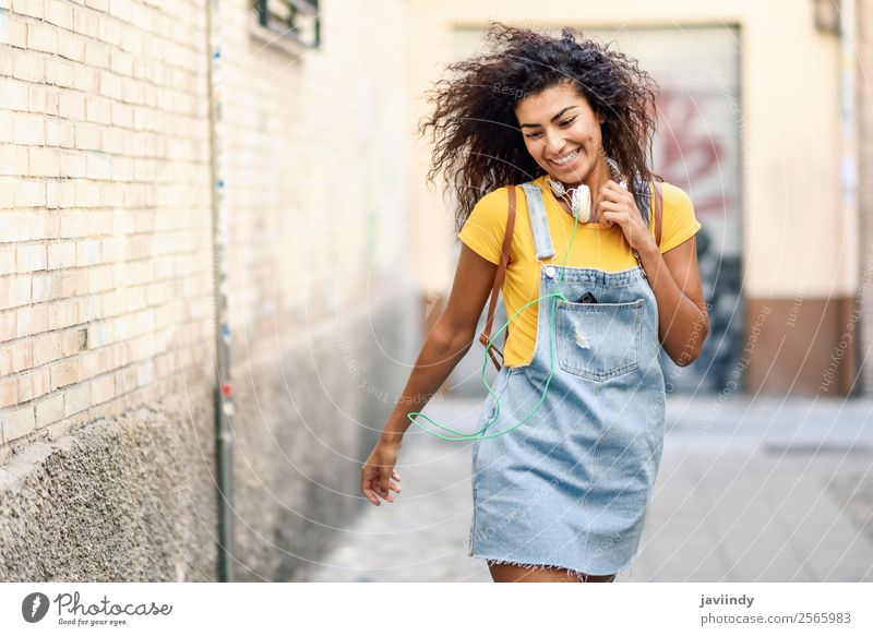 Young African woman with headphones Woman Human being Youth (Young adults) Young woman Beautiful Joy 18 - 30 years Black Street Lifestyle Adults Autumn Feminine