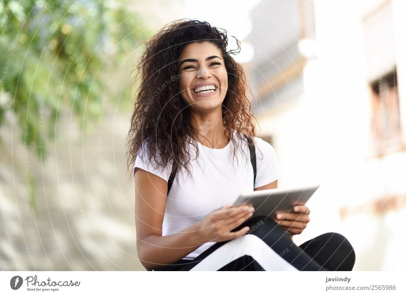 Smiling African woman using digital tablet outdoors. Woman Human being Youth (Young adults) Young woman Beautiful Joy 18 - 30 years Black Street Lifestyle