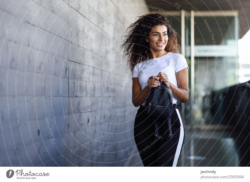 Young African woman with black curly hairstyle Lifestyle Style Happy Beautiful Hair and hairstyles Face Sports Human being Feminine Young woman