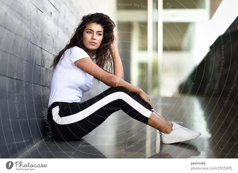 African woman with black curly hairstyle sitting Lifestyle Style Beautiful Hair and hairstyles Face Sports Human being Feminine Young woman Youth (Young adults)