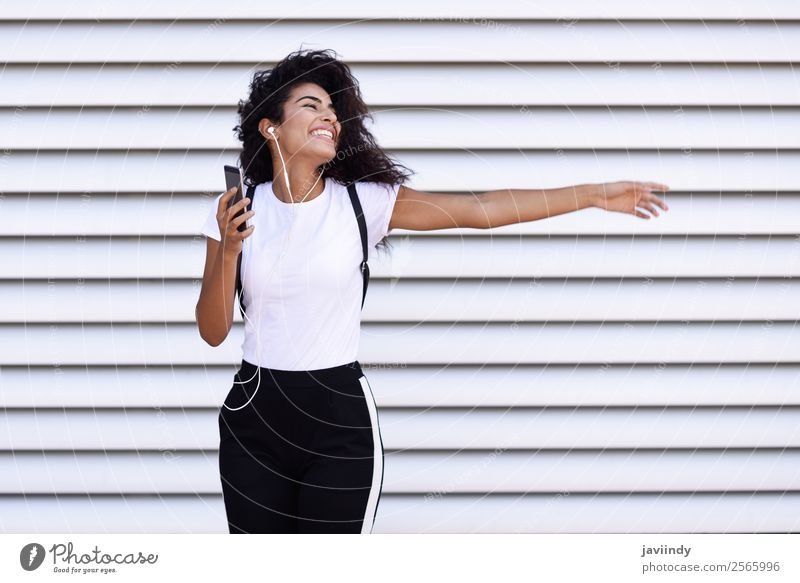 Funny African woman listening to music Style Joy Happy Beautiful Hair and hairstyles Music Sports Telephone PDA Technology Human being Feminine Young woman