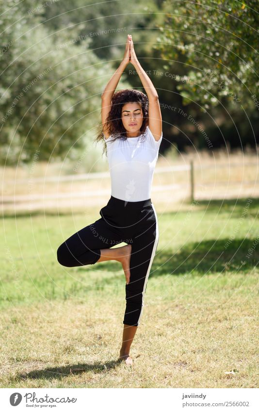 Young Arab woman doing yoga in nature. Lifestyle Beautiful Body Relaxation Calm Meditation Summer Sports Yoga Human being Feminine Young woman