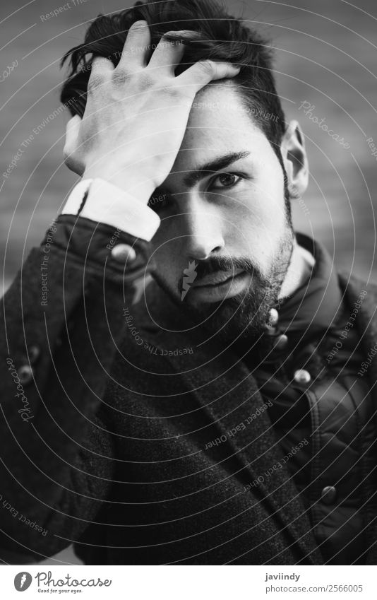 Guy with beard and modern hairstyle touching his hair Lifestyle Elegant Style Beautiful Hair and hairstyles Human being Masculine Young man Youth (Young adults)