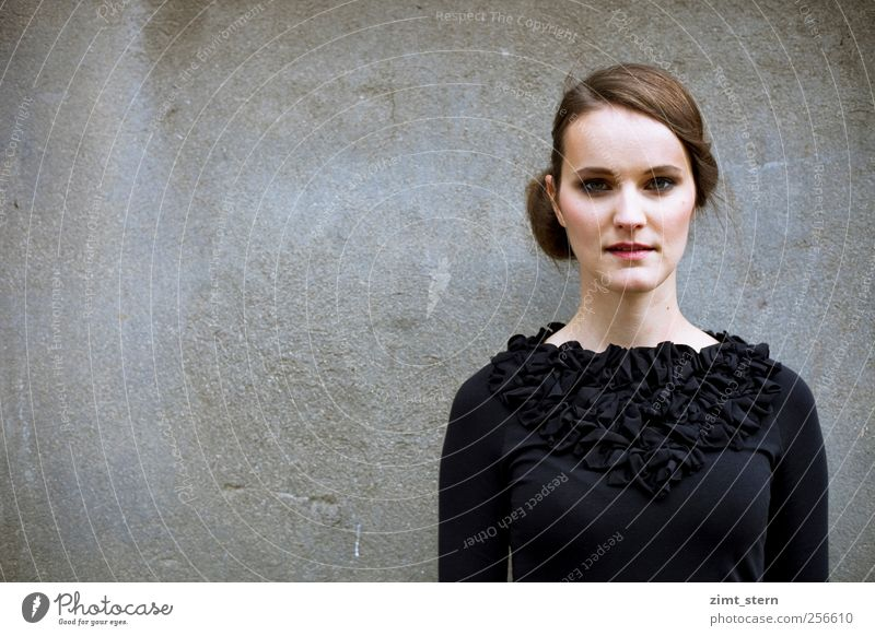 noble black Feminine Young woman Youth (Young adults) 1 Human being Wall (barrier) Wall (building) Frills Brunette Part Breathe Think Looking Stand Dream