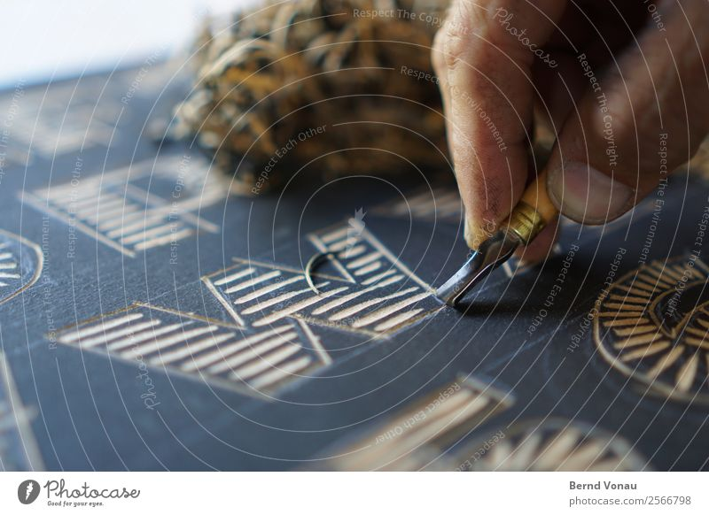 Human being Hand Black Adults Brown Work and employment Leisure and hobbies Masculine 45 - 60 years Esthetic Creativity Fingers Stripe Tradition Typography Tool