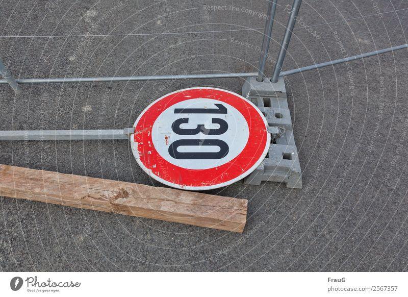 Wood Metal Lie Broken Asphalt Fence Road sign Hoarding Speed limit 130