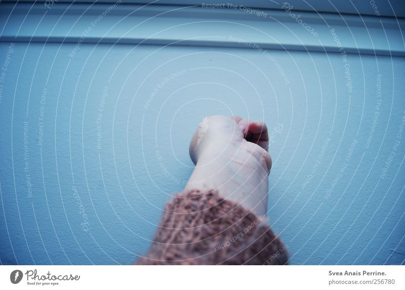 baby blue. Feminine Young woman Youth (Young adults) Arm Hand Fingers Wall (barrier) Wall (building) Cardigan To hold on Cold Colour photo Subdued colour