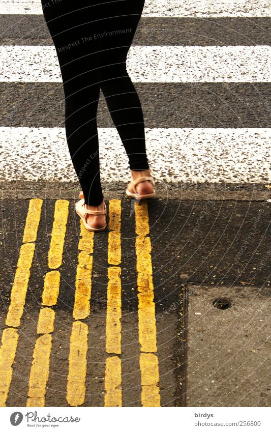What line am I going on? Woman Adults 1 Human being Traffic infrastructure Street Zebra crossing Pedestrian crossing Going Wait Exceptional Yellow Black White