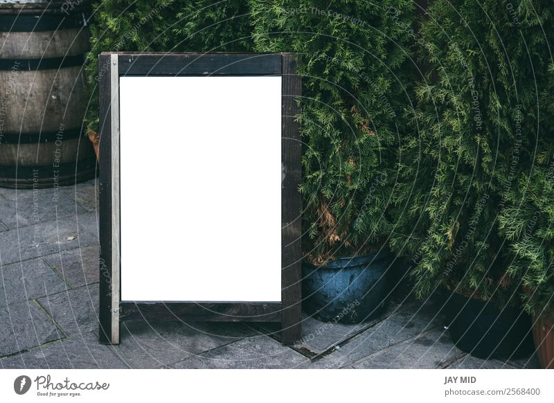 Blank restaurant advertising board, in the street Design Restaurant Blackboard Business Plant Street Wood Stand Advertising Menu Mock-up frame space empty