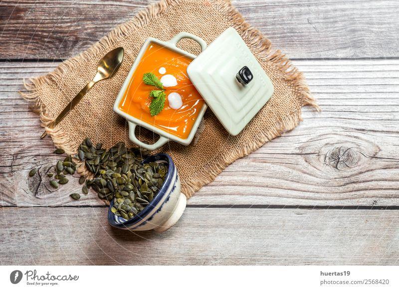 Cream of pumpkin in bowl Food Sausage Vegetable Soup Stew Dinner Vegetarian diet Diet Plate Bowl Spoon Healthy Healthy Eating Hallowe'en Autumn Delicious Above