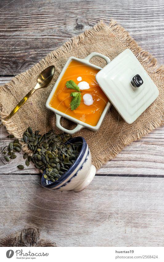 Cream of pumpkin in bowl. Food Sausage Vegetable Soup Stew Dinner Vegetarian diet Diet Plate Bowl Spoon Healthy Eating Hallowe'en Autumn Delicious Above Sour