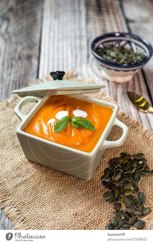 Cream of pumpkin in bowl. Food Sausage Vegetable Soup Stew Dinner Vegetarian diet Diet Plate Bowl Spoon Lifestyle Healthy Healthy Eating Hallowe'en Autumn