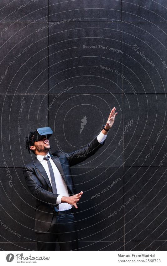 afro businessman playing virtual reality simulation Entertainment Business Headset Technology Young man Youth (Young adults) Adults Hand Suit Touch Modern