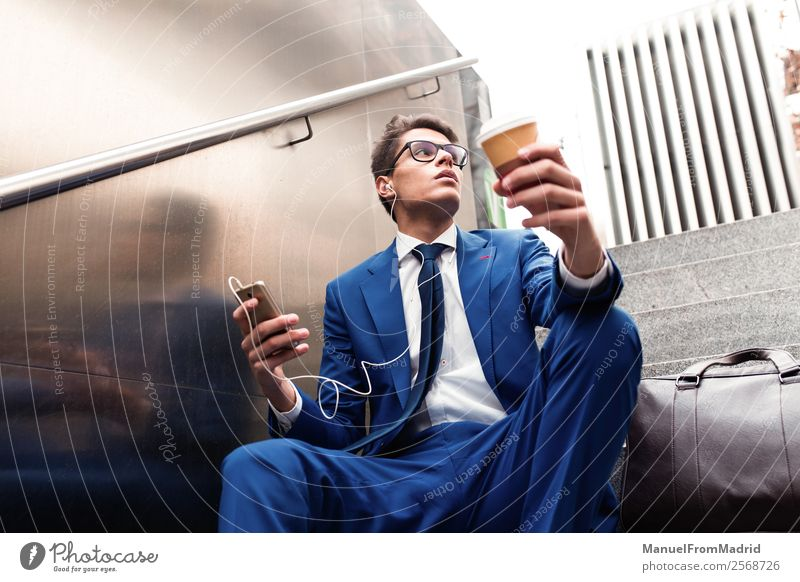 attractive businessman using a phone Lifestyle Style Work and employment Business Telephone Human being Man Adults Street Fashion Suit Modern Smart