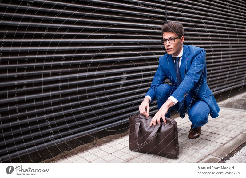 businessman with a briefcase Lifestyle Style Work and employment Business Human being Man Adults Street Fashion Suit Modern Smart Self-confident Businessman