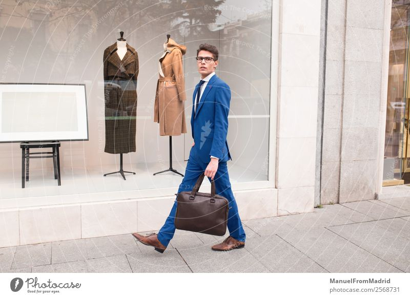 attractive businessman walking down the street Lifestyle Style Work and employment Business Human being Man Adults Street Fashion Suit Modern Smart