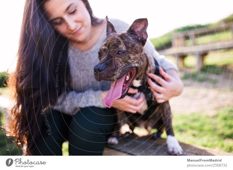 young woman with her dog Lifestyle Happy Beautiful Woman Adults Friendship Nature Animal Grass Park Pet Dog Smiling Cute Green Joy Happiness Trust Safety