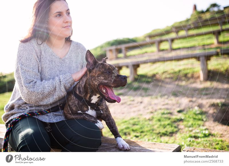 young woman sitting with her dog Woman Nature Dog Beautiful Green Animal Lifestyle Adults Happy Grass Together Friendship Park Smiling Cute Protection