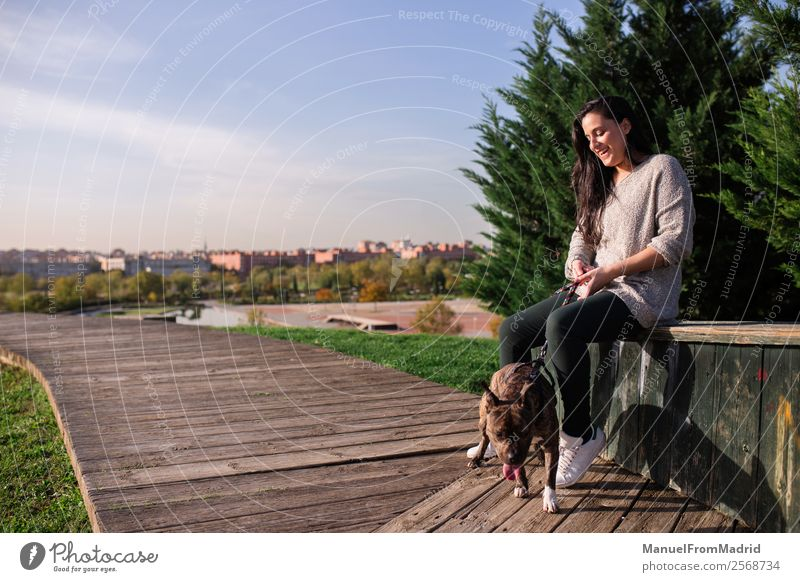 young woman sitting with her dog Woman Nature Dog Beautiful Green Animal Lifestyle Adults Happy Grass Copy Space Together Friendship Leisure and hobbies Park