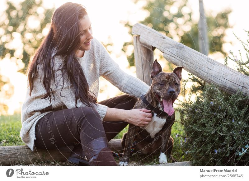 young woman with her dog at a park Woman Nature Dog Beautiful Green Animal Lifestyle Adults Happy Grass Together Friendship Park Smiling Happiness Authentic