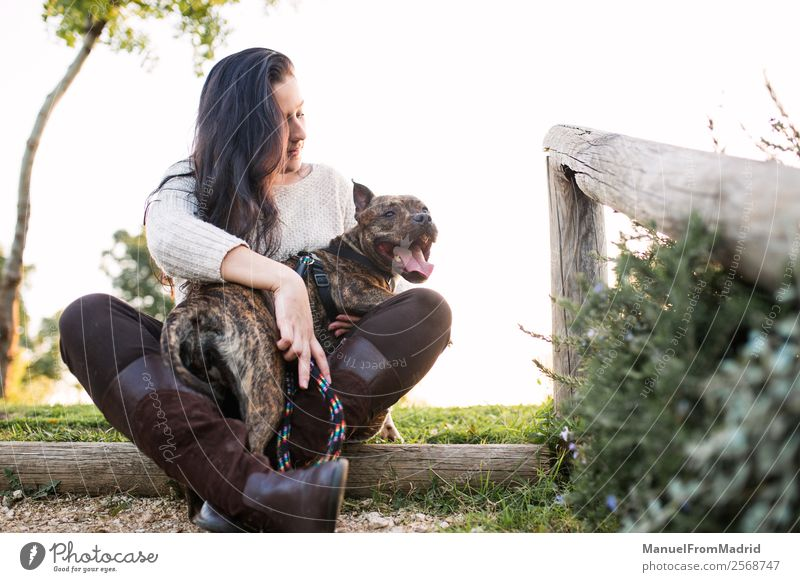 young woman with her dog at a park Woman Nature Dog Beautiful Green Relaxation Animal Joy Lifestyle Adults Natural Happy Grass Together Friendship