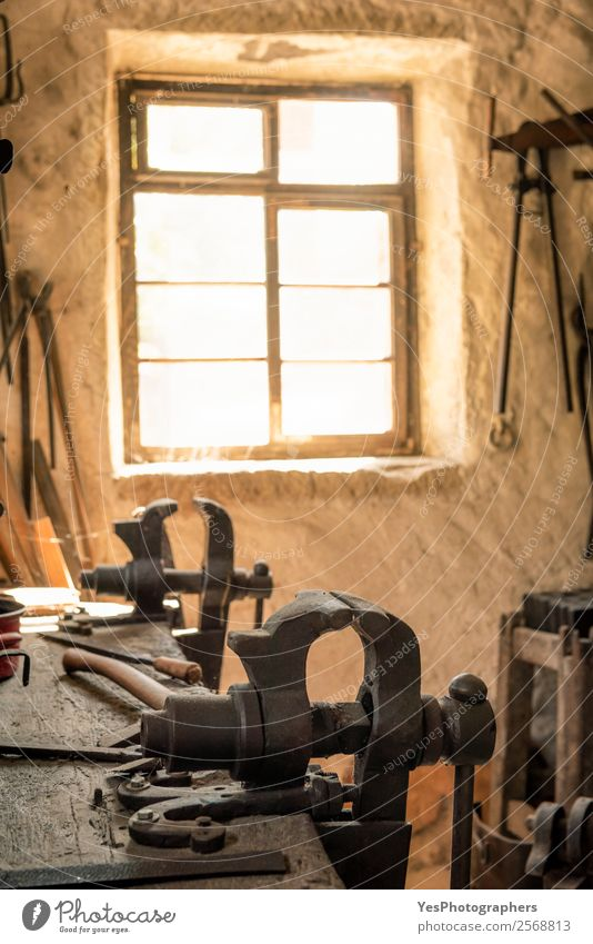 Blacksmith workbench with a vise grip Old Window Wall (building) Wall (barrier) Moody Illuminate Retro Profession Tradition Optimism Ancient Weathered Antique