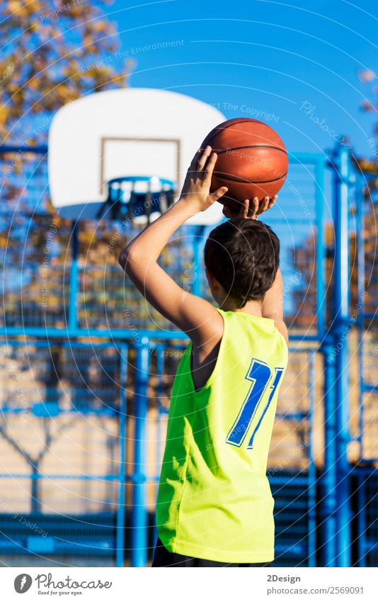 teenager throwing a basketball into the hoop from behind Lifestyle Joy Relaxation Leisure and hobbies Playing Sports Human being Boy (child) Man Adults Clothing