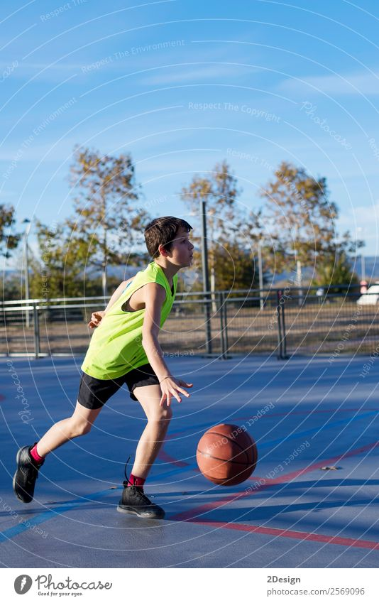 Teenage playing basketball on an outdoors court Child Human being Man Relaxation Joy Black Lifestyle Adults Sports Boy (child) Playing Leisure and hobbies