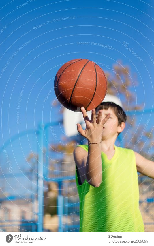 Teenage playing basketball on an outdoors court Lifestyle Joy Relaxation Leisure and hobbies Playing Sports Human being Boy (child) Man Adults Clothing Hat