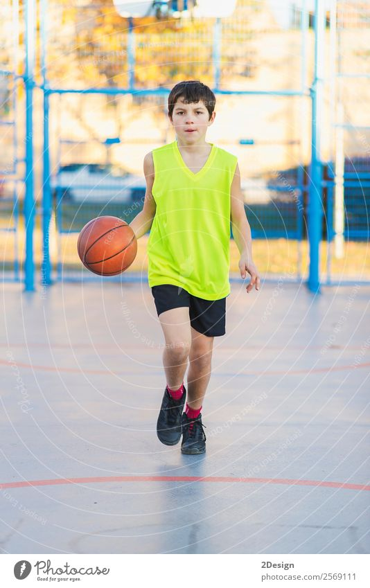 Teenage playing basketball on an outdoors court Lifestyle Joy Relaxation Leisure and hobbies Playing Sports Human being Masculine Boy (child) Man Adults 1