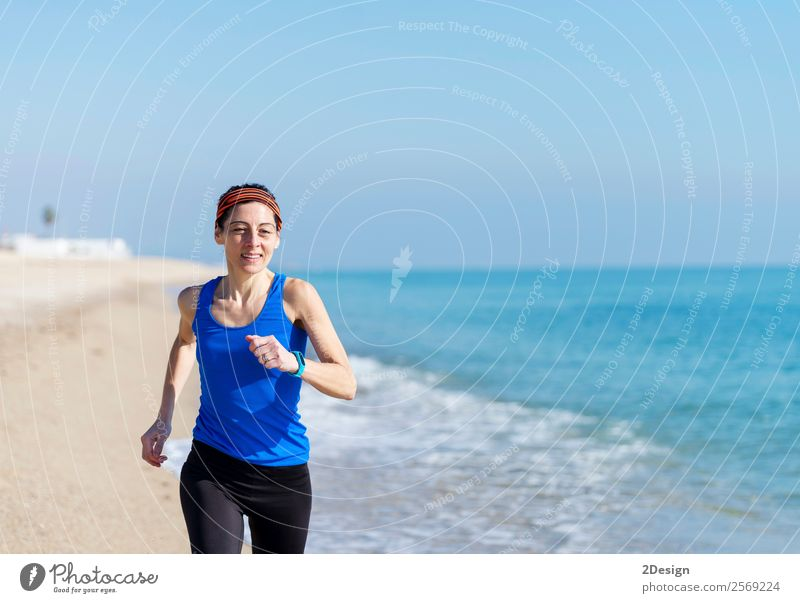 Woman Exercising On Beach ( running ) Human being Vacation & Travel Youth (Young adults) Young woman Summer Ocean Adults Feminine Coast Sports Happy Copy Space