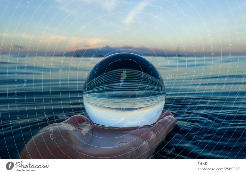 Stripes in Surface of Sea Close Up in Glass Ball Calm Vacation & Travel Ocean Waves Hand Environment Nature Landscape Sky Virgin forest Sphere Wet Blue Serene